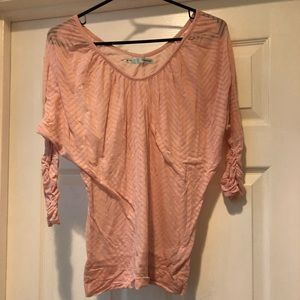 Sheer, pink quarter sleeved shirt.